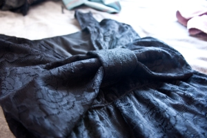 little black dress with bowtie andblack lace
